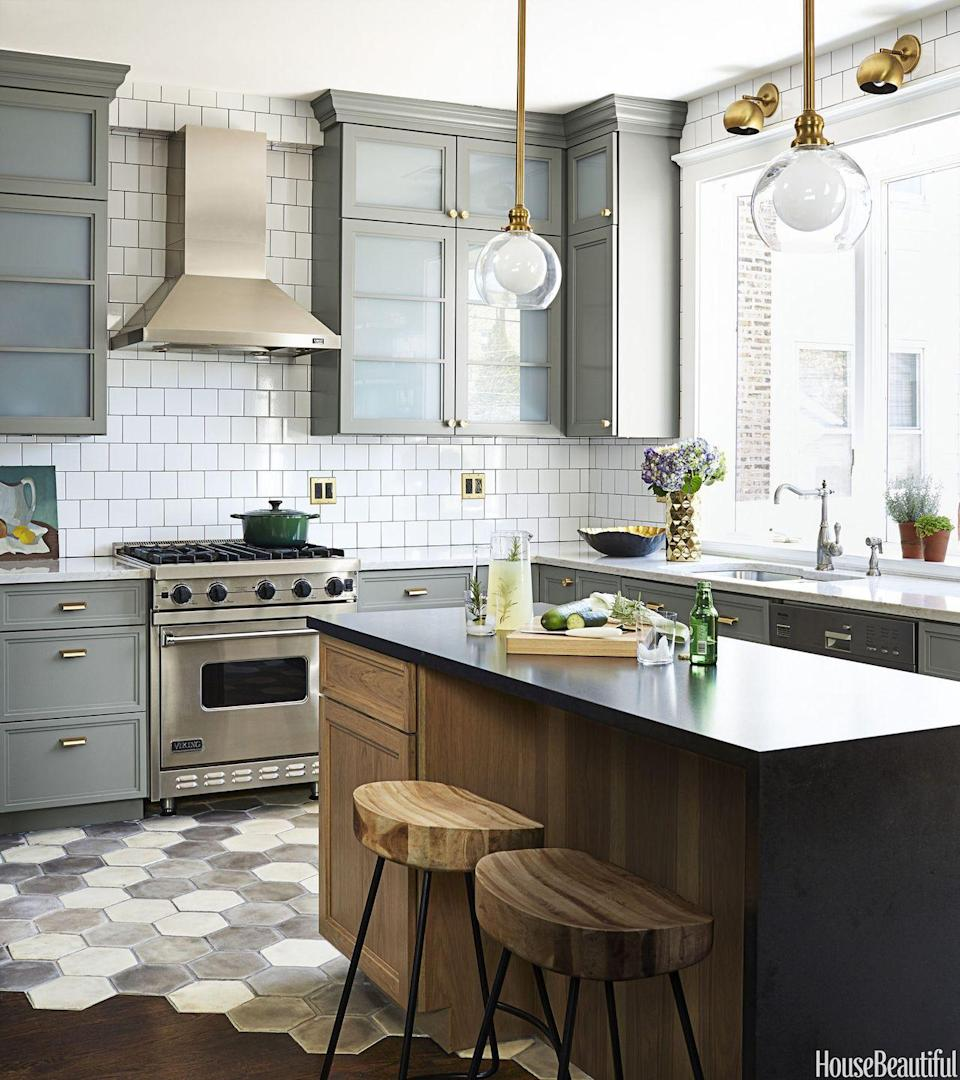 "<p>Though the color palette is neutral, <a href=""https://www.housebeautiful.com/room-decorating/kitchens/a3953/suzann-kletzien-kitchen-chicago/"" rel=""nofollow noopener"" target=""_blank"" data-ylk=""slk:this muted kitchen"" class=""link rapid-noclick-resp"">this muted kitchen</a> by SuzAnn Kletzien gets its cool factor thanks to the fixtures and mixed metals. The overall effect is calming, but definitely not boring. </p>"