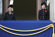 Britain's Camilla, the Duchess of Cornwall and Kate, the Duchess of Cambridge watche from the balcony of the Foreign Office, during the Remembrance Sunday service at the Cenotaph, in Whitehall, London, Sunday Nov. 8, 2020. (Peter Nicholls/Pool Photo via AP)