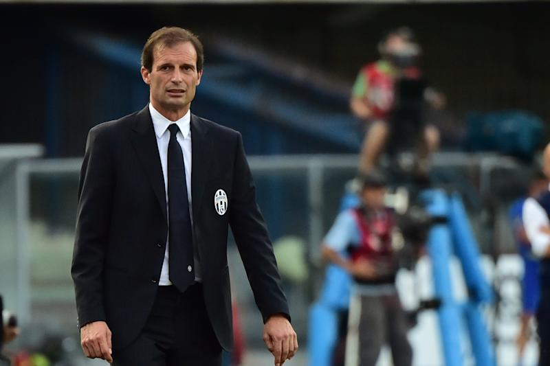 Juventus coach Massimiliano Allegri looks on during the Serie A football match Chievo Verona vs Juventus at Bentegodi Stadium in Verona on August 30, 2014 (AFP Photo/Giuseppe Cacace)