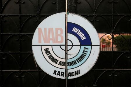 FILE PHOTO: A logo of the National Accountability Bureau (NAB) is seen on the main entrance of their office in Karachi