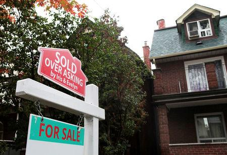 "FILE PHOTO --  A ""Sold over asking"" sign is on display on a house for sale in Toronto's housing market in Toronto"