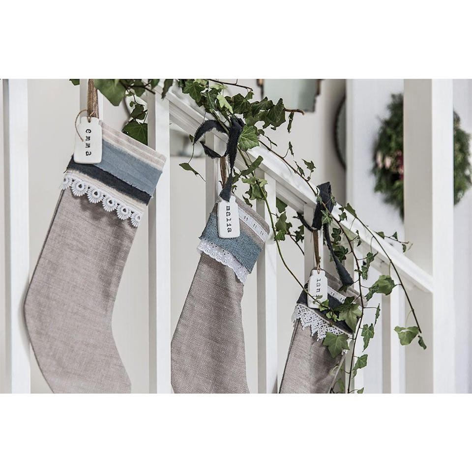 <p>If you don't have a mantel, the stairs are a great alternative for hanging stockings. These personalized ones will get your family excited for Christmas while adding a chic holiday accent to your staircase.</p>