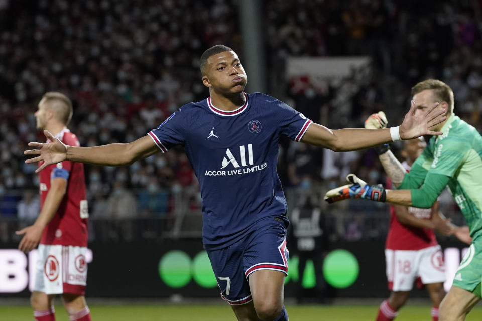 PSG's Kylian Mbappe celebrates after scoring his side's second goal during a French League One soccer match between Brest and PSG at the Francis-Le Ble stadium in Brest, France, Friday, Aug. 20, 2021. (AP Photo/Daniel Cole)