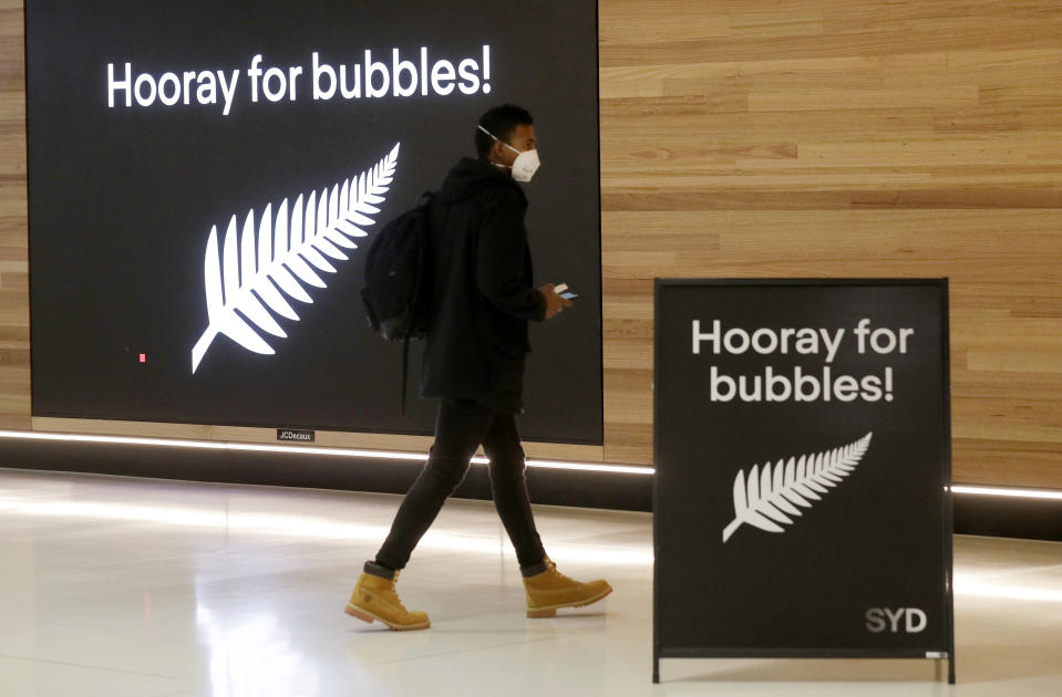 A passenger prepares at Sydney Airport, in Sydney, Australia, Monday, April 19, 2021, to catch a flight to New Zealand as the much-anticipated travel bubble between Australia and New Zealand opens. (AP Photo/Rick Rycroft)