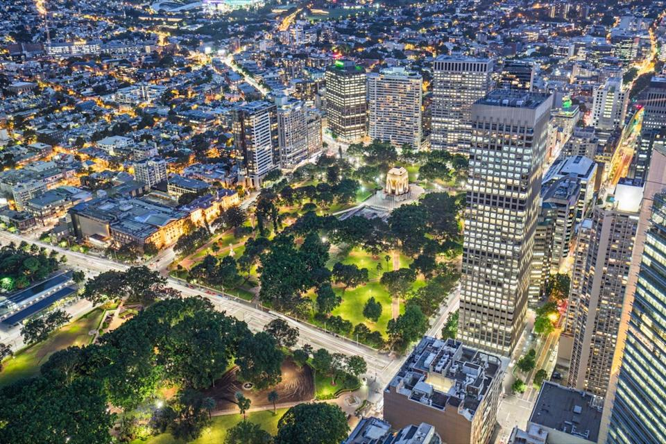 Elevated view of Hyde Park with Anzac War Memorial at dusk, Sydney, NSW, Australia