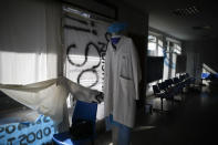 A waiting room sits empty inside San Andres Clinic which has been occupied by its former workers since it closed at the start of the year following the death of the hospital's director and owner in Caseros, Argentina, Friday, April 30, 2021. While the pandemic has swelled the need for hospital beds, many private clinics say they're struggling to survive, citing the pandemic having pushed away many non-COVID patients and losing money on coronavirus sufferers because the government insurance program doesn't pay enough to meet costs. (AP Photo/Natacha Pisarenko)