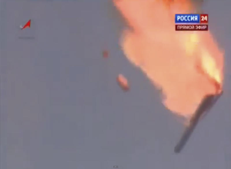 In this frame grab made from TV footage distributed by Russian Vesti 24 channel Russian booster rocket carrying three satellites crashes at a Russia-leased cosmodrome in Kazakhstan on Tuesday July 2, 2013 shortly after the launch The Proton-M booster unexpectedly shut down the engine 17 seconds into the flight and crashed some 2 kilometers (over a mile) away from the Baikonur launch pad, the Russian Space Agency said in a statement. (AP Photo/ Vesti 24 via APTN) TV OUT
