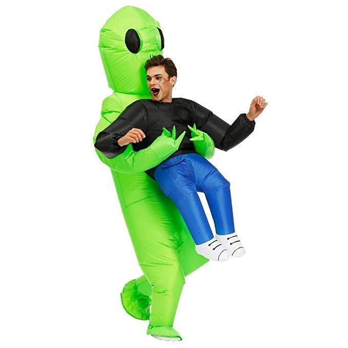 inflatable alien costume holding a man