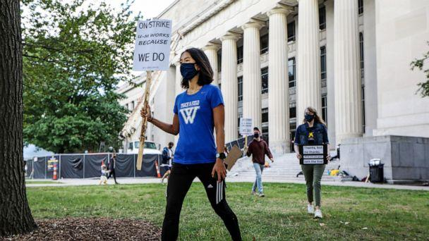 PHOTO: Members of the Graduate Employees' Organization Local 3550 protest outside of Angell Hall on the University of Michigan campus in Ann Arbor, Mich., Sept. 11, 2020. (Kimberly P. Mitchell/Detroit Free Press via USA Today Network)