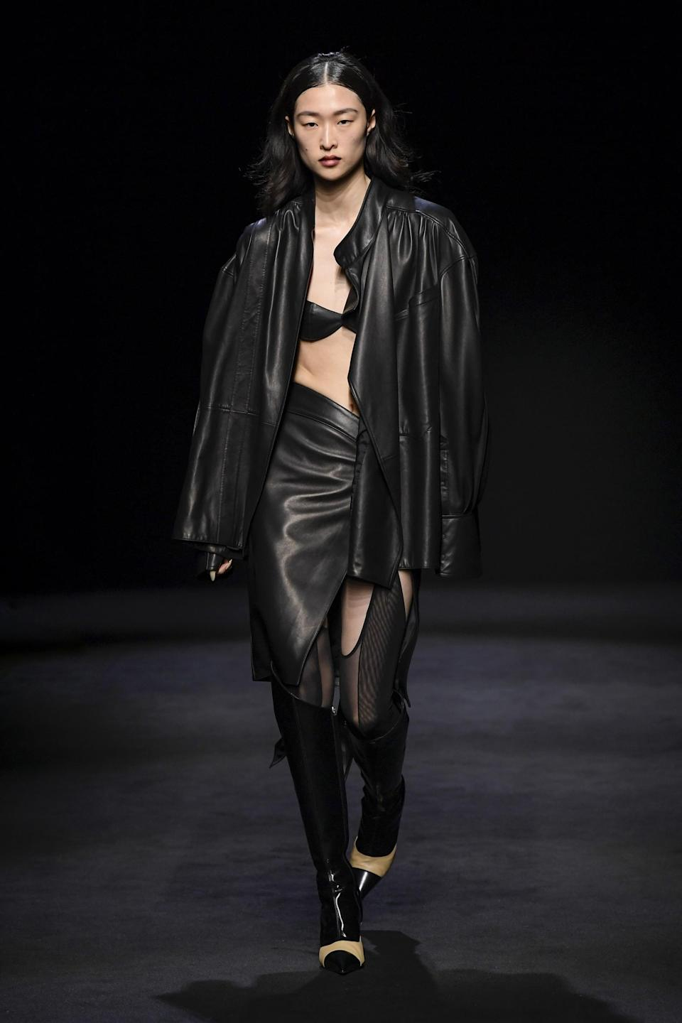 <p>You can always count on Mugler to bring a sultry flare to Paris Fashion Week. To achieve the look, opt for structural silhouettes, mesh peek-a-boo elements, body-clinging leather, and, of course, bodysuits.</p>