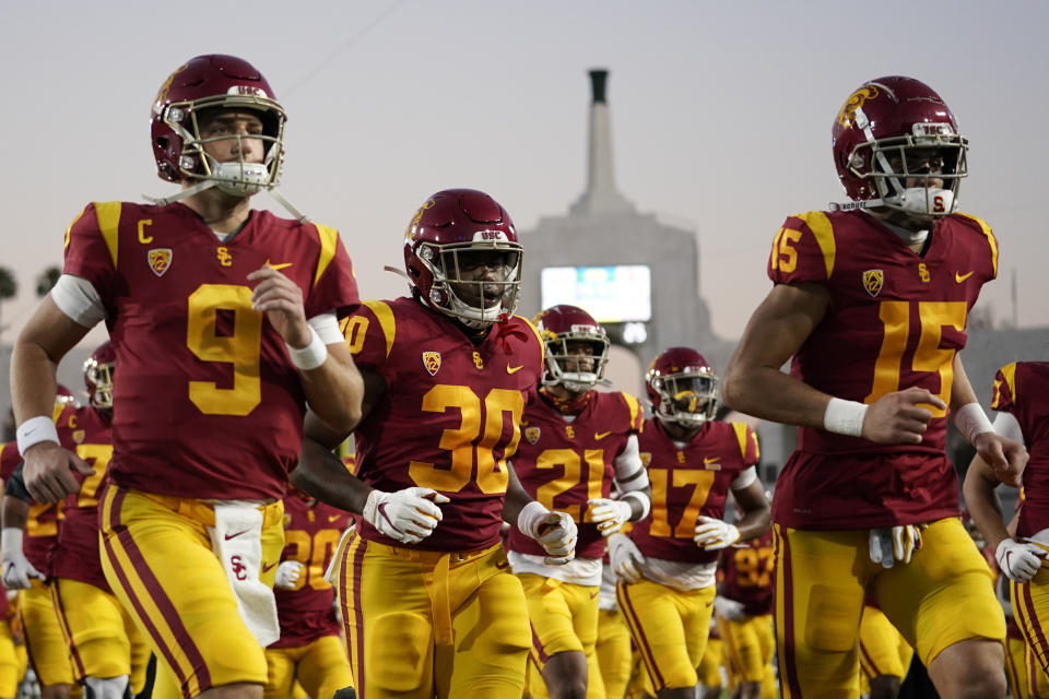Southern California players run off the field after warming up before an NCAA college football game against Oregon for the Pac-12 Conference championship Friday, Dec 18, 2020, in Los Angeles. (AP Photo/Ashley Landis)
