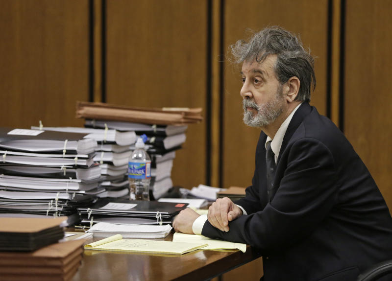 The man who calls himself Bobby Thompson listens to opening arguments in his trial in Cleveland, Monday, Oct. 7, 2013. Thompson, 67, who authorities have identified as John Donald Cody, is charged with masterminding a $100 million multistate fraud under the guise of helping Navy veterans. (AP Photo/Mark Duncan)