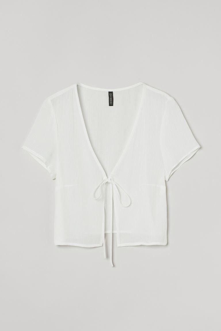 <p>This <span>Tie-top Blouse</span> ($13) will look cool and effortless when styled with jeans and sneakers.</p>
