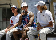 Olympic skateboarder Nyjah Huston, center, and joined by teammates during a news conference in downtown Los Angeles on Monday, June 21, 2021. Huston and the rest of the first U.S. Olympic skateboarding team was introduced in Southern California on Monday where the sport was invented roughly 70 years ago. Skateboarding is an Olympic sport for the first time in Tokyo, and the Americans are expected to be a strong team. (AP Photo/Richard Vogel)