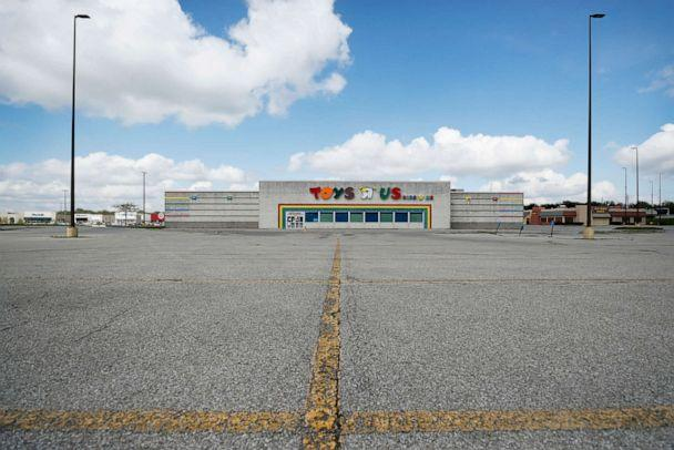 PHOTO: A closed Toys R Us building sits in front of an empty parking lot, Wednesday, May 6, 2020, in Des Moines, Iowa. (Charlie Neibergall/AP)