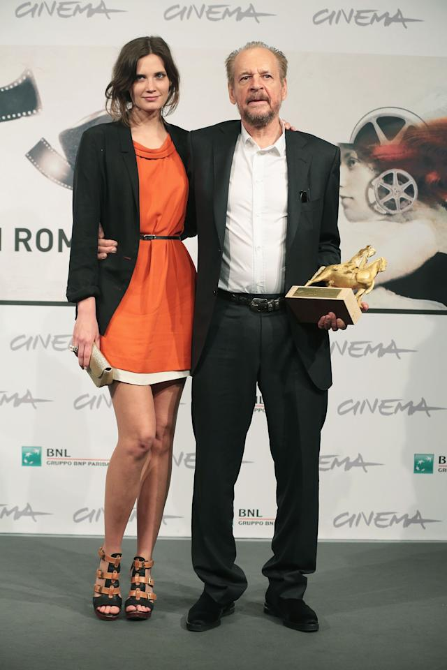 ROME, ITALY - NOVEMBER 17:  Director Larry Clark (R) poses with his Golden Marc'Aurelio Award for Best Film 'Marfa Girl' with actress Drake Burnette during the Award Winners Photocall during the 7th Rome Film Festival at Auditorium Parco Della Musica on November 17, 2012 in Rome, Italy.  (Photo by Elisabetta Villa/Getty Images)