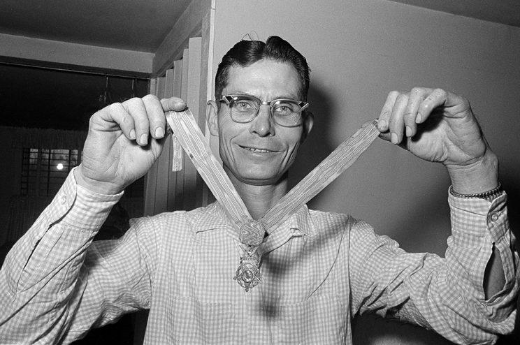 Desmond T. Doss, a Seventh Day Adventist and the only conscientious objector to win the Medal of Honor, displays his medal at his home in Rising Fawn, Ga., April 5, 1966. Doss won the medal as a medic on Okinawa in 1945. He says he would serve again if called upon. (AP Photo)