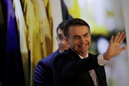 Brazil's President Jair Bolsonaro waves at an inauguration ceremony of the new president of the Parliamentary Agricultural Front (FPA) in Brasilia, Brazil February 19, 2019. REUTERS/Ueslei Marcelino
