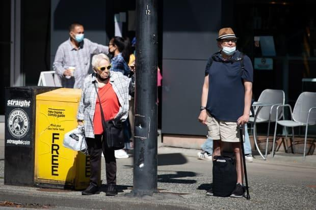 Pedestrians in Vancouver on Sept. 7.  (Maggie MacPherson/CBC - image credit)