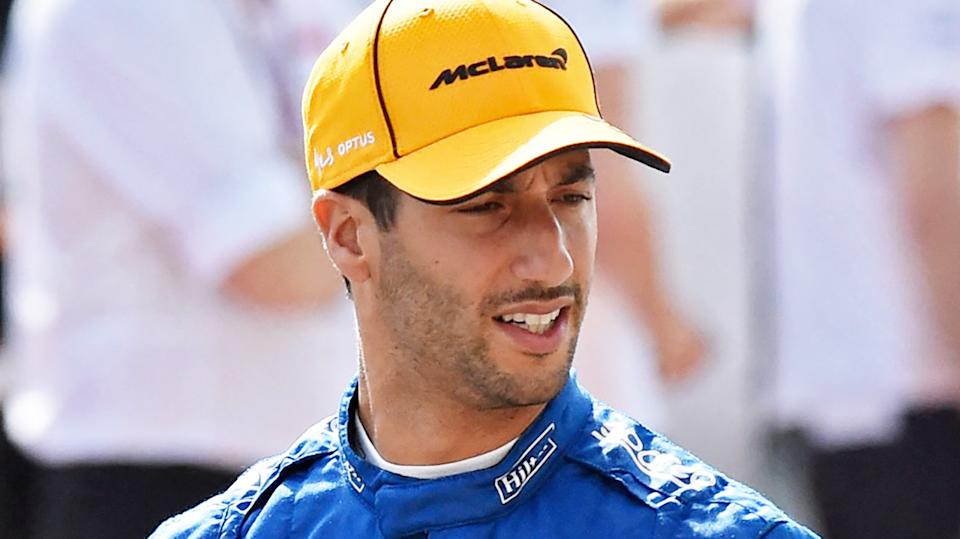 Daniel Ricciardo is pictured wearing his McLaren race suit.