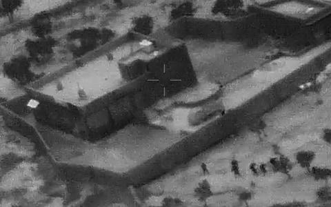 US Special Forces, figures at lower right, moving toward compound of Islamic State leader Abu Bakr al-Baghdadi  - Credit: Department of Defense