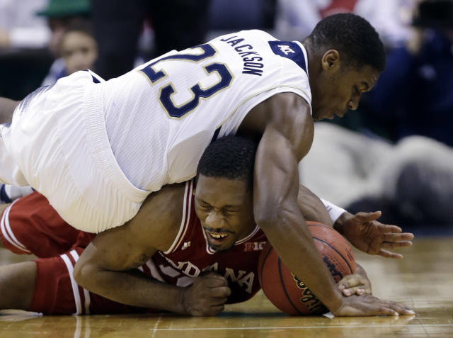 Notre Dame guard Demetrius Jackson, top, comes down on Indiana guard Stanford Robinson as they go for a loose ball in the second half of an NCAA college basketball game in Indianapolis, Saturday, Dec. 14, 2013. Notre Dame defeated Indiana 79-72. (AP Photo/Michael Conroy)