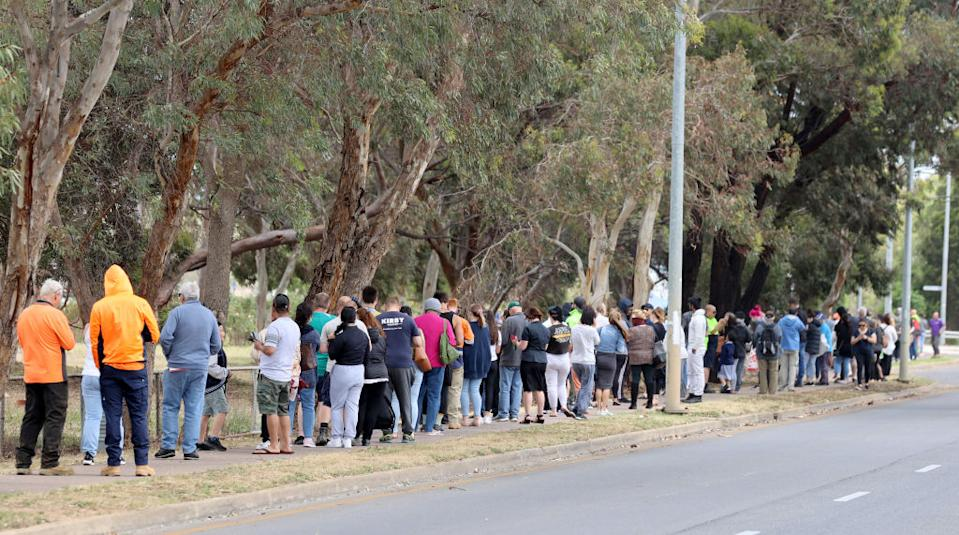 People queuing at the Covid-19 Testing site at Parafield Airport in Adelaide.