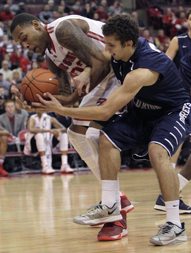 Ohio State's Amir Williams, left, grabs a rebound away from North Florida's Sean Brennan during the second half of an NCAA college basketball game on Friday, Nov. 29, 2013, in Columbus, Ohio. Ohio State won 99-64. (AP Photo/Jay LaPrete)