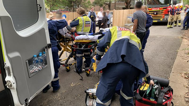 The man is seen being treated by paramedics. Source: Careflight