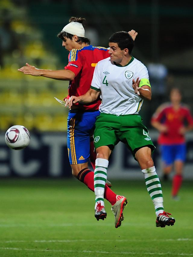 Alvaro Morata (L) of Spain vies with John Egan (R) of Ireland during their UEFA European Under-19 Championship football match, near the village of Chiajna village, outside of Bucharest, on July 29, 2011. AFP PHOTO/DANIEL MIHAILESCU (Photo credit should read DANIEL MIHAILESCU/AFP/Getty Images)
