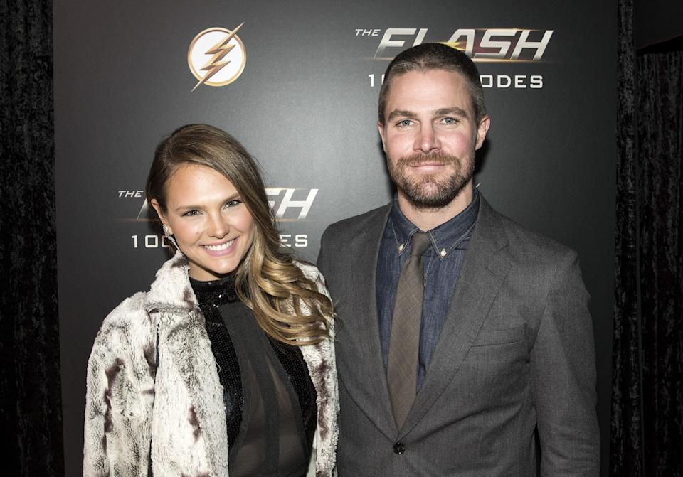 VANCOUVER, BC - NOVEMBER 17: (L-R) Actors Cassandra Jean Whitehead and Stephen Amell attend the red carpet at