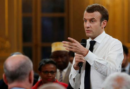 "French President Emmanuel Macron gestures as he speaks during a meeting with mayors of oversee territories as part of the ""national debate"" in Paris, France, February 1, 2019. Michel Euler/Pool via REUTERS"