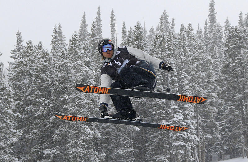 Norway's Andreas Haatveit grabs a ski as he launches off a jump during the World Cup U.S. Grand Prix slopestyle freestyle skiing finals, Saturday, Dec. 21, 2013, in Frisco, Colo. Haatveit won first place in the event. (AP Photo/Julie Jacobson)