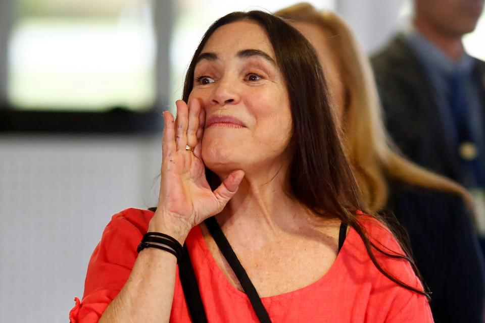 Brazilian actress Regina Duarte gestures as she leaves the Planalto Palace in Brasilia after a meeting with Brazilian President Jair Bolsonaro, on January 29, 2020. - A famous soap opera actress will become the new culture secretary, replacing a man fired over a speech that appeared to quote Adolf Hitler's propaganda minister Joseph Goebbels. (Photo by Sergio LIMA / AFP) (Photo by SERGIO LIMA/AFP via Getty Images)