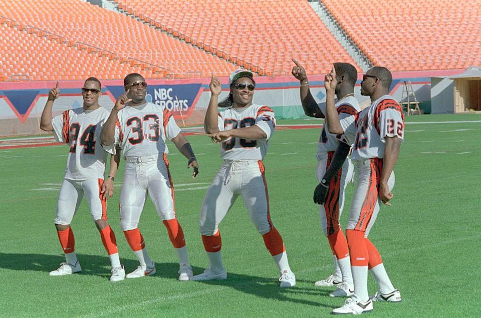 Ickey Woods, center, teaches his teammates the 'Ickey Shuffle' in 1989. (Getty)