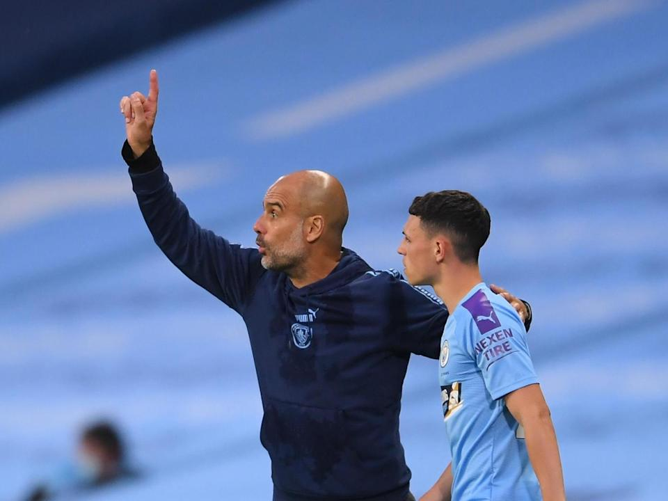 Man City manager Pep Guardiola (left) with Phil Foden: Getty Images