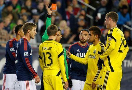 Nov 9, 2014; Foxborough, MA, USA; Referee Armando Villarreal issues a red card to Columbus Crew midfielder Ethan Finlay (13) after he ran into New England Revolution goalkeeper Bobby Shuttleworth during the second half at Gillette Stadium. Mandatory Credit: Winslow Townson-USA TODAY Sports