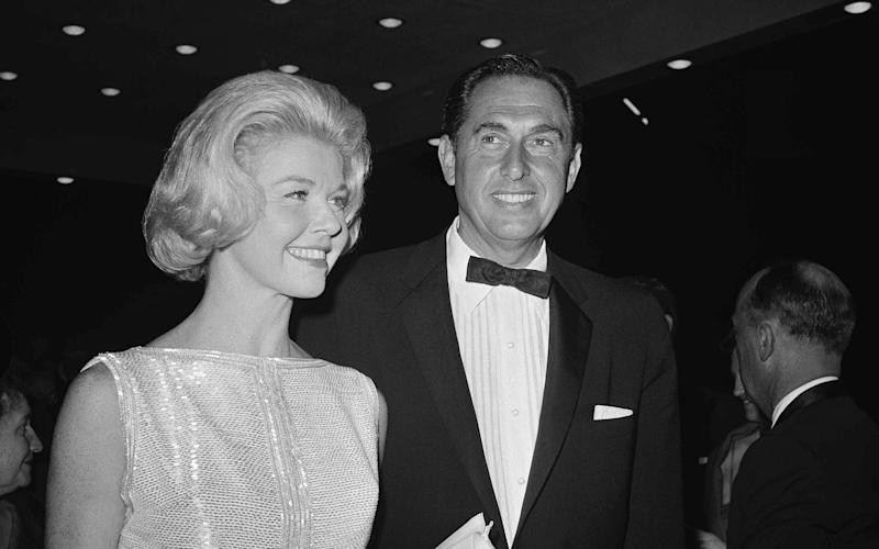 Doris Day, pictured in 1960 with husband Marty Melcher, is two years older than she thought - AP