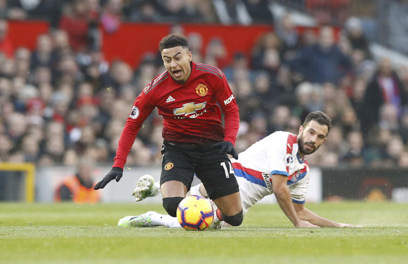 Manchester United's Jesse Lingard left is fouled by Crystal Palace's Luka Milivojevic during their English Premier League soccer match at Old Trafford Manchester England Saturday Nov. 24 2018