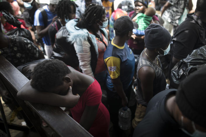Migrants wait to board a boat that will take them to Capurgana, on the border with Panama, from Necocli, Colombia, Thursday, July 29, 2021. Migrants have been gathering in Necocli as they move north towards Panama on their way to the U.S. border. (AP Photo/Ivan Valencia)
