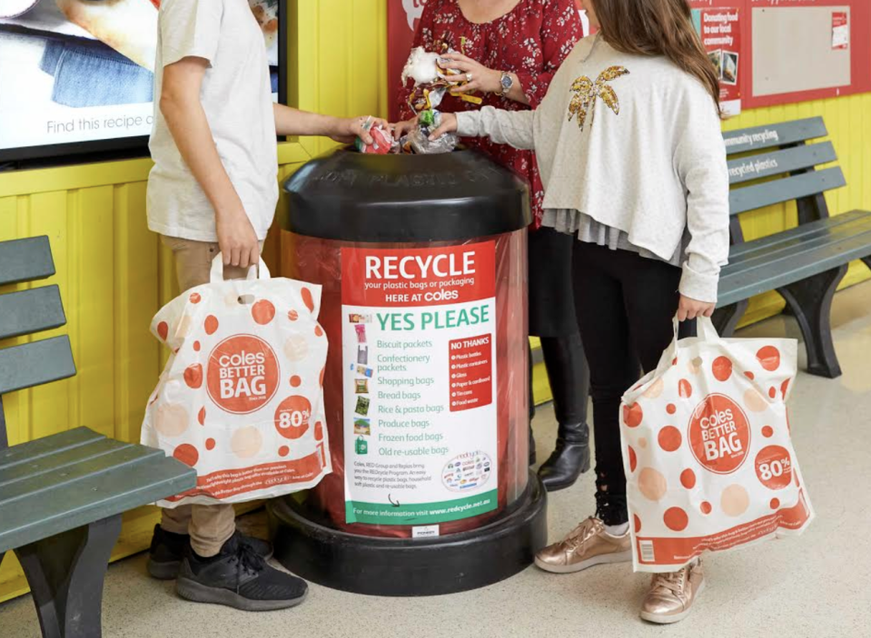 Shoppers placing soft plastics in a REDcycle bin outside a Coles store. Source: Coles