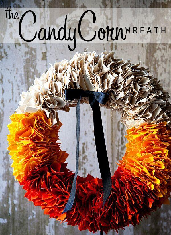 """<p>Combine yellow, orange, and white canvas fabric to turn the colors of the classic candy into a creative front-door centerpiece. </p><p><strong>Get the tutorial at <a href=""""http://www.thehouseofsmiths.com/2011/10/candy-corn-wreath-tutorial-by-heather.html"""" rel=""""nofollow noopener"""" target=""""_blank"""" data-ylk=""""slk:The House of Smiths"""" class=""""link rapid-noclick-resp"""">The House of Smiths</a>.</strong></p>"""