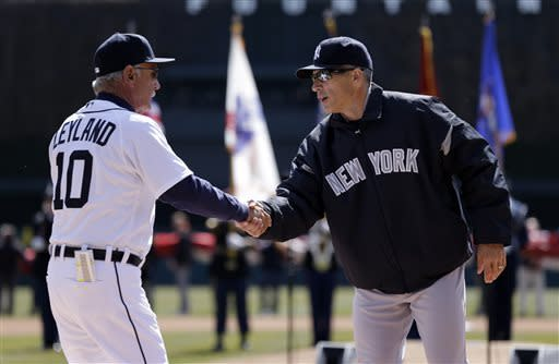 Detroit Tigers manager Jim Leyland, left, and New York Yankees manager Joe Girardi shake hands before a opening day baseball game in Detroit, Friday April 5, 2013. (AP Photo/Paul Sancya)