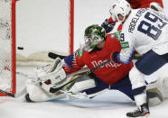 Norway's goaltender Henrik Haukeland fails to stop a goal by Conor Garland of the US during the Ice Hockey World Championship group B match between Norway and United States at the Arena in Riga, Latvia, Saturday, May 29, 2021. (AP Photo/Sergei Grits)