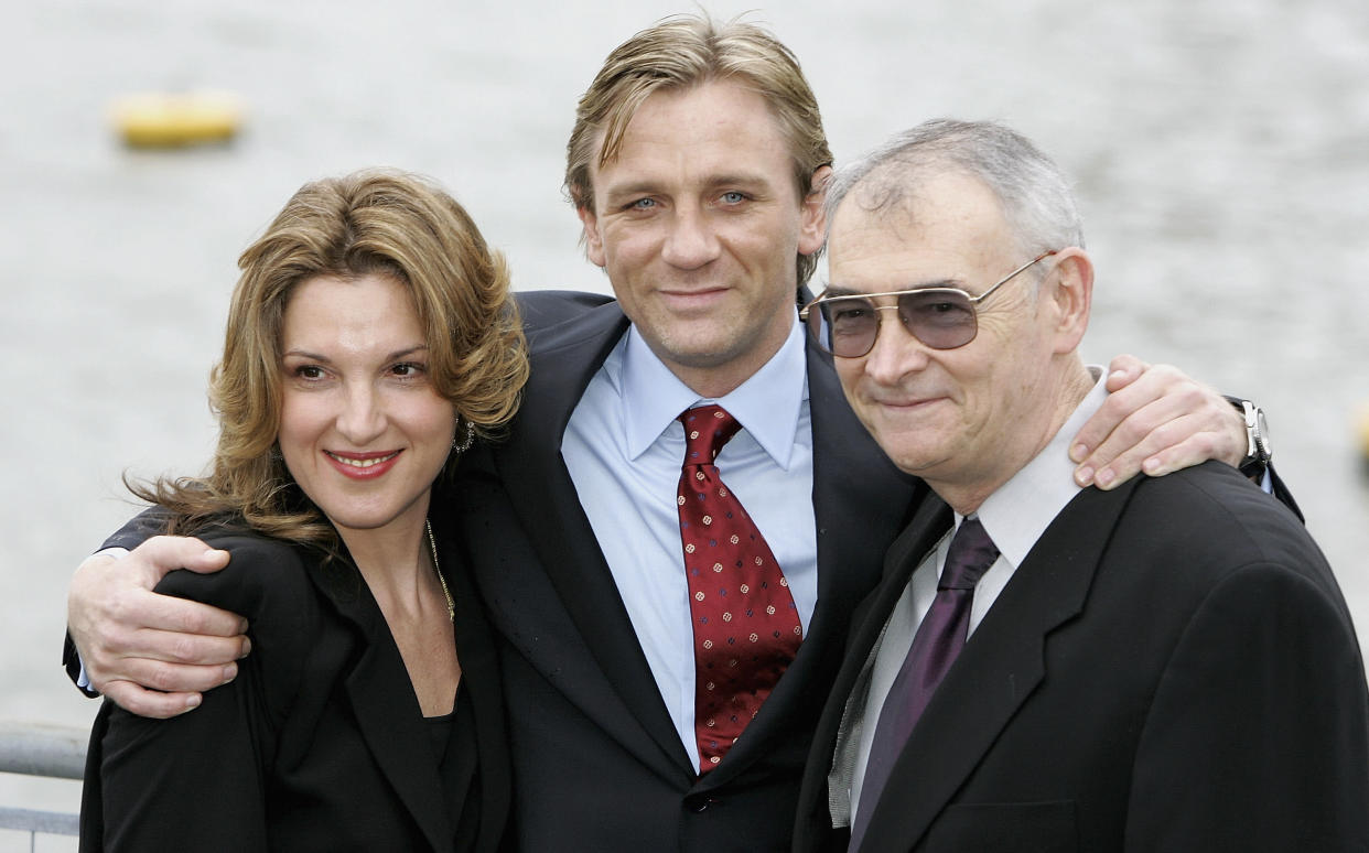 LONDON - OCTOBER 14:  Actor Daniel Craig (C) poses with Barbara Broccoli (L) and Michael G Wilson (R) as he is unveiled as the new actor to play the legendary British secret agent James Bond 007 in the 21st Bond film Casino Royale, at HMS President, St Katharine's Way on October 14, 2005 in London, England. Speculation as to who might replace Pierce Brosnan (who played Bond from 1995-2002) has been fierce, with Clive Owen, Jude Law, Ewan McGregor, Colin Salmon, Colin Farrell and Goran Visnjic in the running, but the most likely candidates were whittled down to Craig and Henry Cavill until today's decision.  (Photo by Chris Jackson/Getty Images)