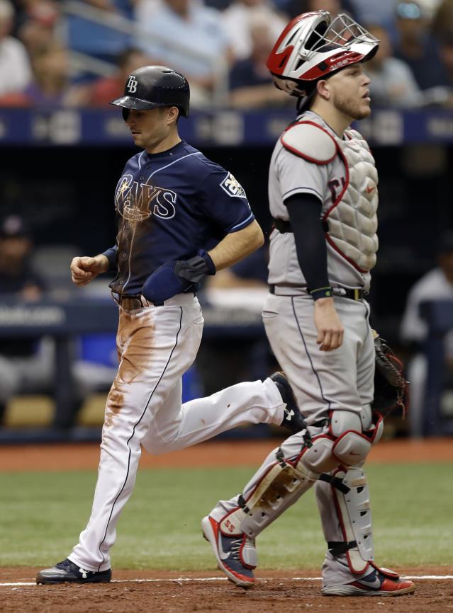 Tampa Bay Rays' Brandon Lowe, left, scores behind Cleveland Indians catcher Roberto Perez on a sacrifice fly by Kevin Kiermaier during the fourth inning of a baseball game Wednesday, Sept. 12, 2018, in St. Petersburg, Fla. (AP Photo/Chris O'Meara)