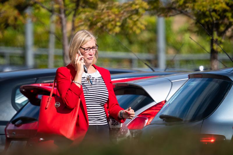 Devastated staff left Thomas Cook's head office on Monday. Photo: SWNS