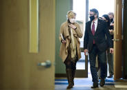FILE - In this Oct. 26, 2020, file photo, Dr. Deborah Birx, White House Coronavirus Response Coordinator, left, walks with North Dakota Gov. Doug Burgum after holding a roundtable discussion with state and local government and medical leaders on the campus of Bismarck State College, in Bismarck, N.D. With coronavirus cases soaring in North Dakota, Burgum has allowed the state's beleaguered hospitals to use infected but asymptomatic doctors and nurse to treat COVID-19 patients. (Mike McCleary/The Bismarck Tribune via AP, File)