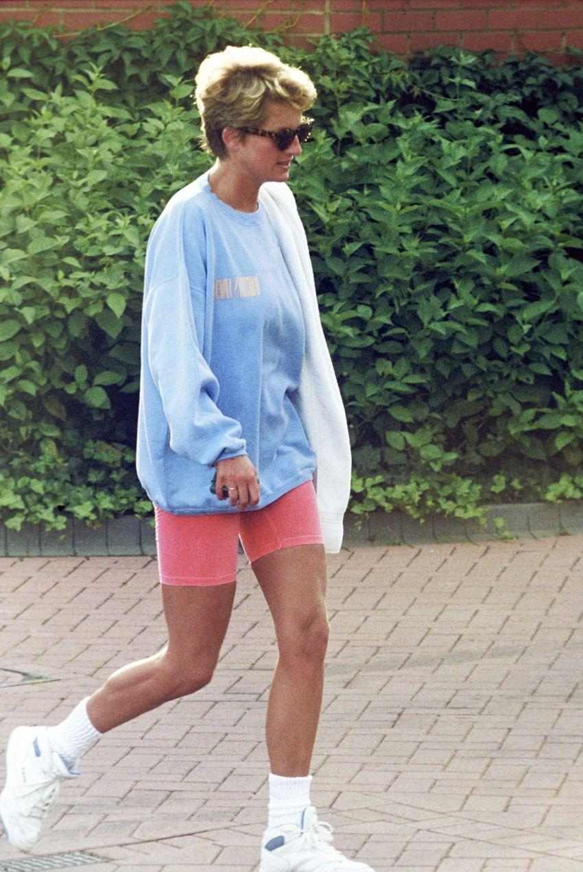 WHO: Princess Diana. Style Notes: Though your first instinct might be to test out the tricky trend with a plain black pair, Princess Di's pastel-colored look offers a fresh take on wearing bike shorts.