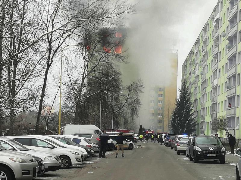 A fire burns as a gas explosion severely damaged a 12th storey apartment building in Presov, Slovakia, Friday, Dec. 6, 2019. The firefighters said the explosion occurred between the ninth and 12th storey and witnesses told them several people have escaped to the roof. Authorities didn't immediately confirm any injuries or fatalities. (AP Photo/Police of Slovakia/HO)
